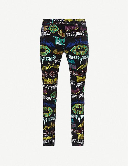 0ec8ccb8976 GUCCI Metal slim-fit skinny jeans