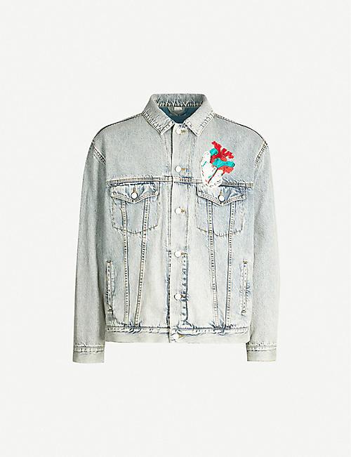 4f8f0811925 GUCCI Oversized faded denim jacket