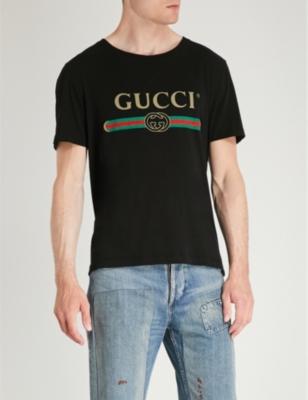 5731840cc GUCCI - Fake logo-print cotton-jersey T-shirt   Selfridges.com