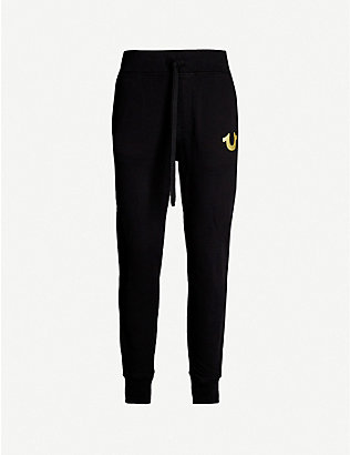 TRUE RELIGION: Logo-embroidered cotton-jersey jogging bottoms