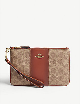COACH: Leather coated canvas pouch