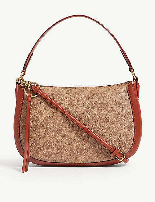 89e72af0df57 COACH Sutton coated canvas cross-body bag