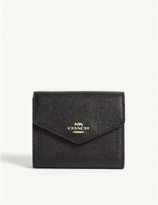 COACH: Textured leather wallet