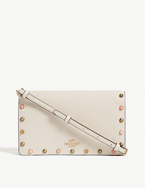 b10dea360515 COACH Studded leather cross-body bag. Quick view Wish list