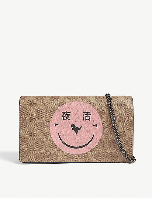 813a549d8f6 COACH Yeti Out leather cross-body clutch