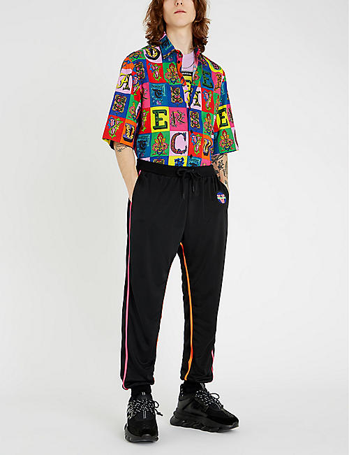 9d907542a VERSACE Relaxed-fit logo-print stretch-jersey tapered jogging bottoms