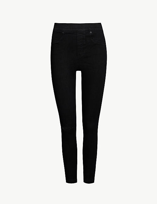 SPANX: Distressed skinny jeans