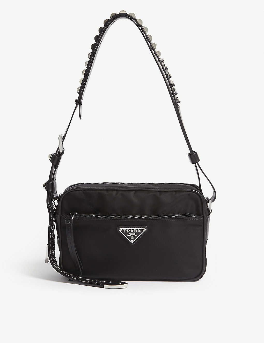 8a2d470311f5 PRADA - Studded strap nylon shoulder bag | Selfridges.com
