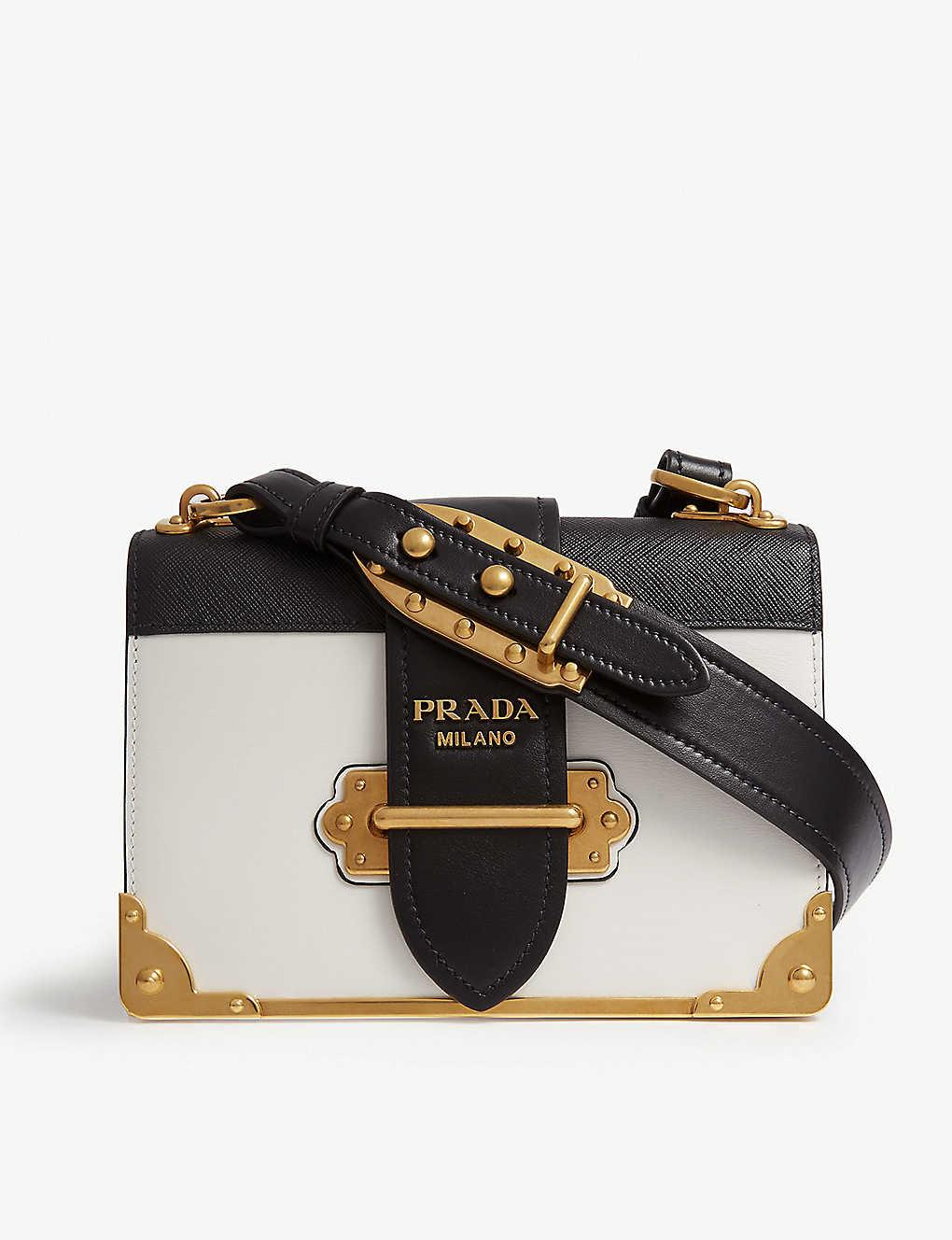 ea9214edd3 PRADA - Cahier leather shoulder bag   Selfridges.com