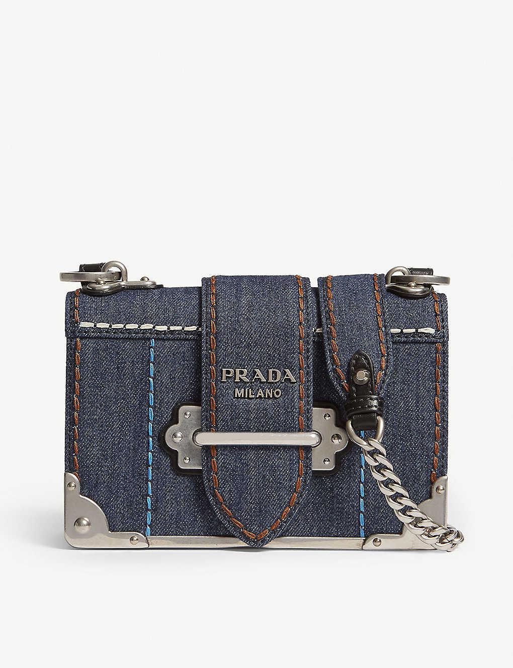 69d5fefe3a2a PRADA - Cahier denim mini shoulder bag | Selfridges.com