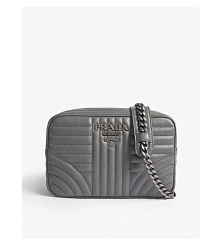 2d334e824a14 PRADA - Diagramme medium leather cross-body camera bag | Selfridges.com
