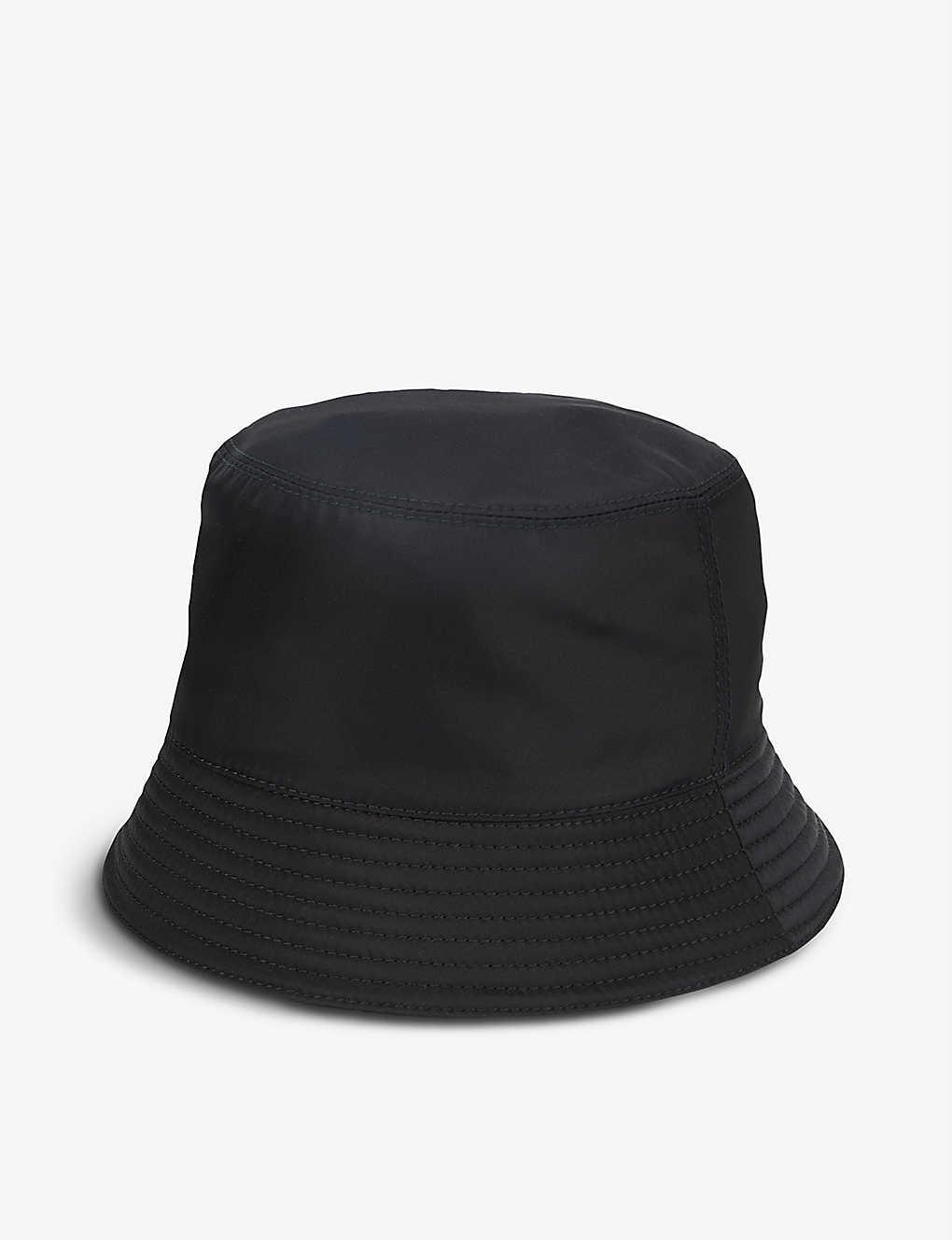 9b531833 PRADA - Logo nylon bucket hat | Selfridges.com