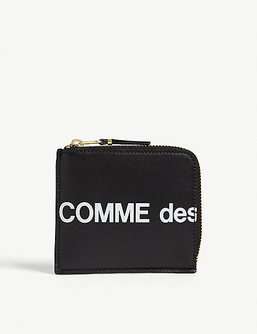 COMME DES GARCONS: Logo print leather wallet
