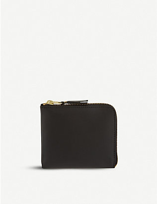 COMME DES GARCONS: Leather half-zip wallet