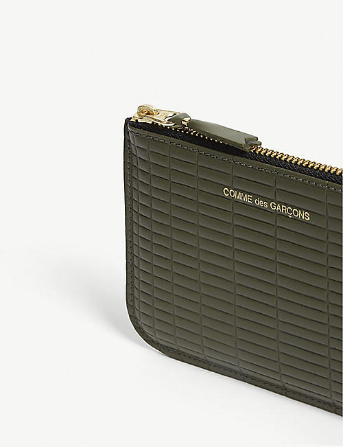 COMME DES GARCONS Brick-embossed leather pouch