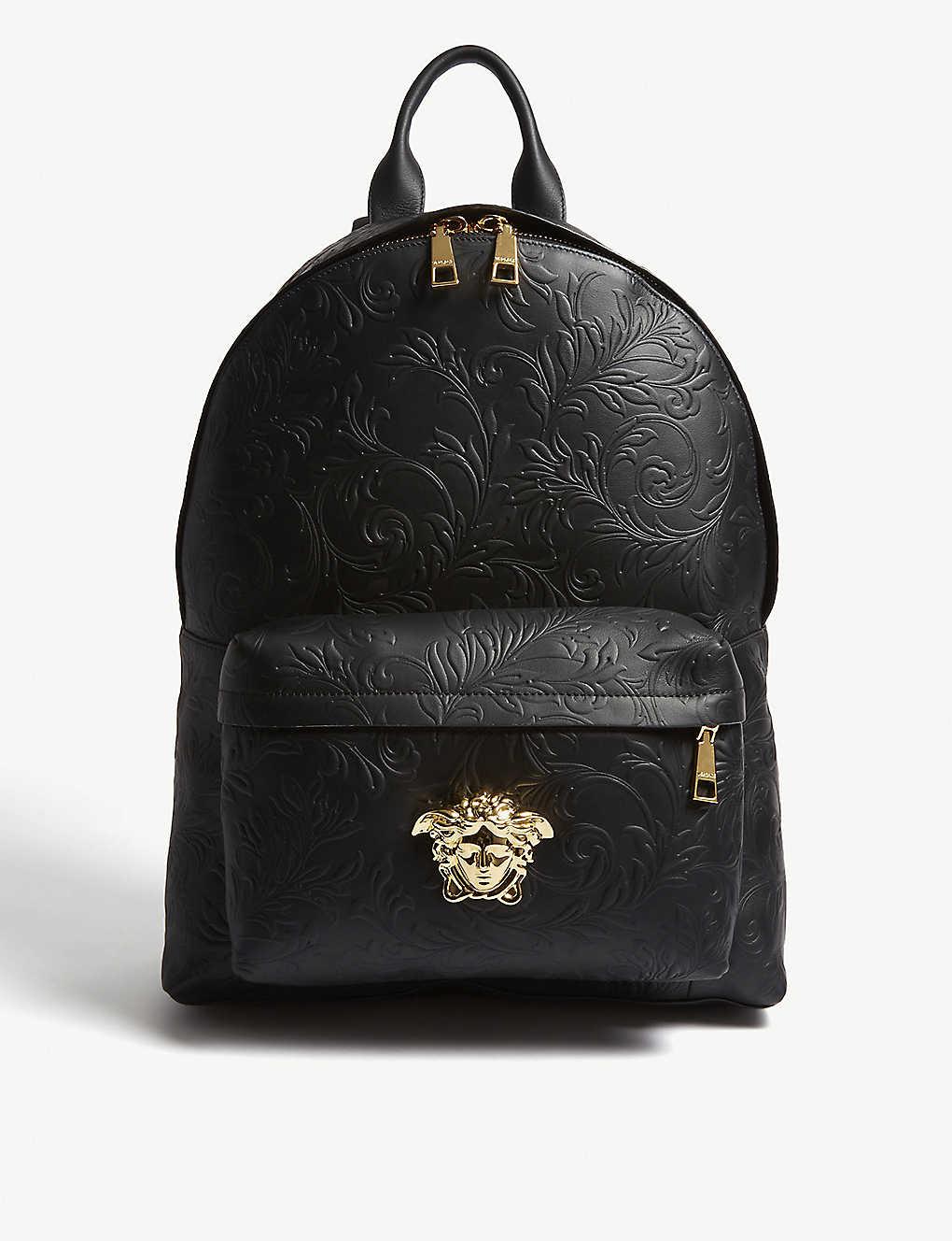 5b11dccab8 VERSACE - Medusa patterned leather backpack | Selfridges.com