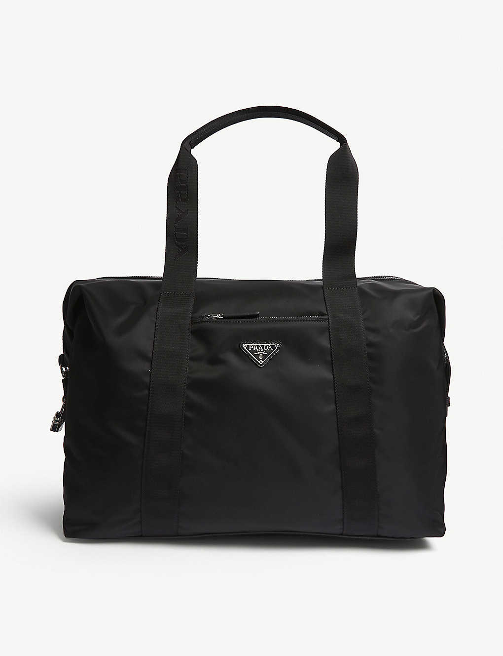 60a574b8ed46 PRADA - Nylon technical weekender bag | Selfridges.com