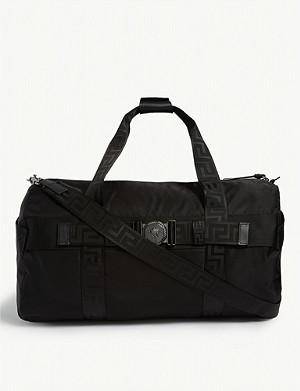 2df27804eac213 PRADA - Nylon technical weekender bag | Selfridges.com