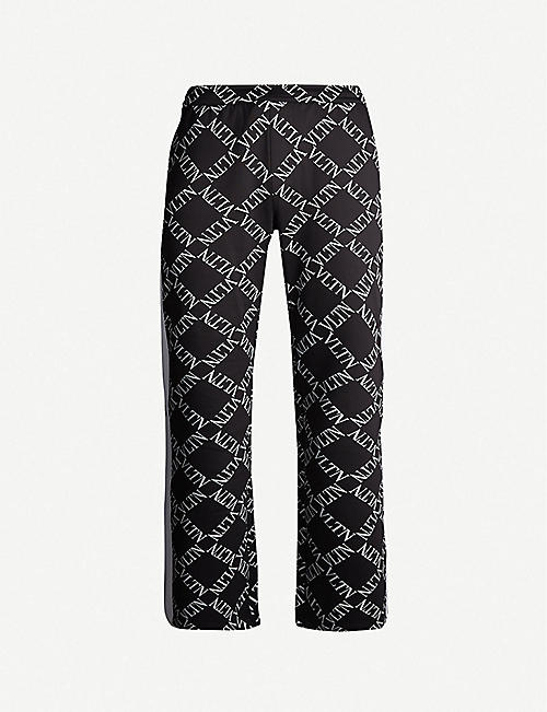 fac47be195d6 VALENTINO Logo-print tapered stretch-cotton trousers