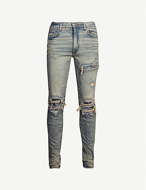 cc2c982f8a70 AMIRI MX1 ripped slim-fit skinny jeans