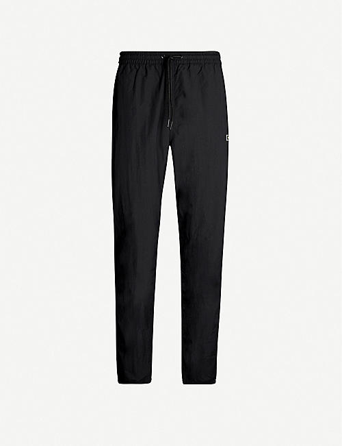FINGERCROXX Brand-print logo-patch shell trousers