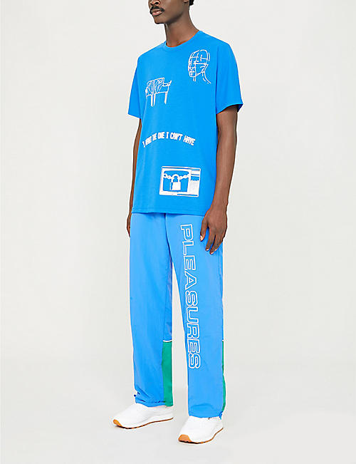 REEBOK PLEASURES graphic-print shell jogging bottoms