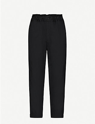 BLACK COMME DES GARCON: Tapered drawstring-waist wool trousers