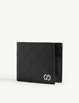 GUCCI Dorian Signature embossed leather bifold wallet