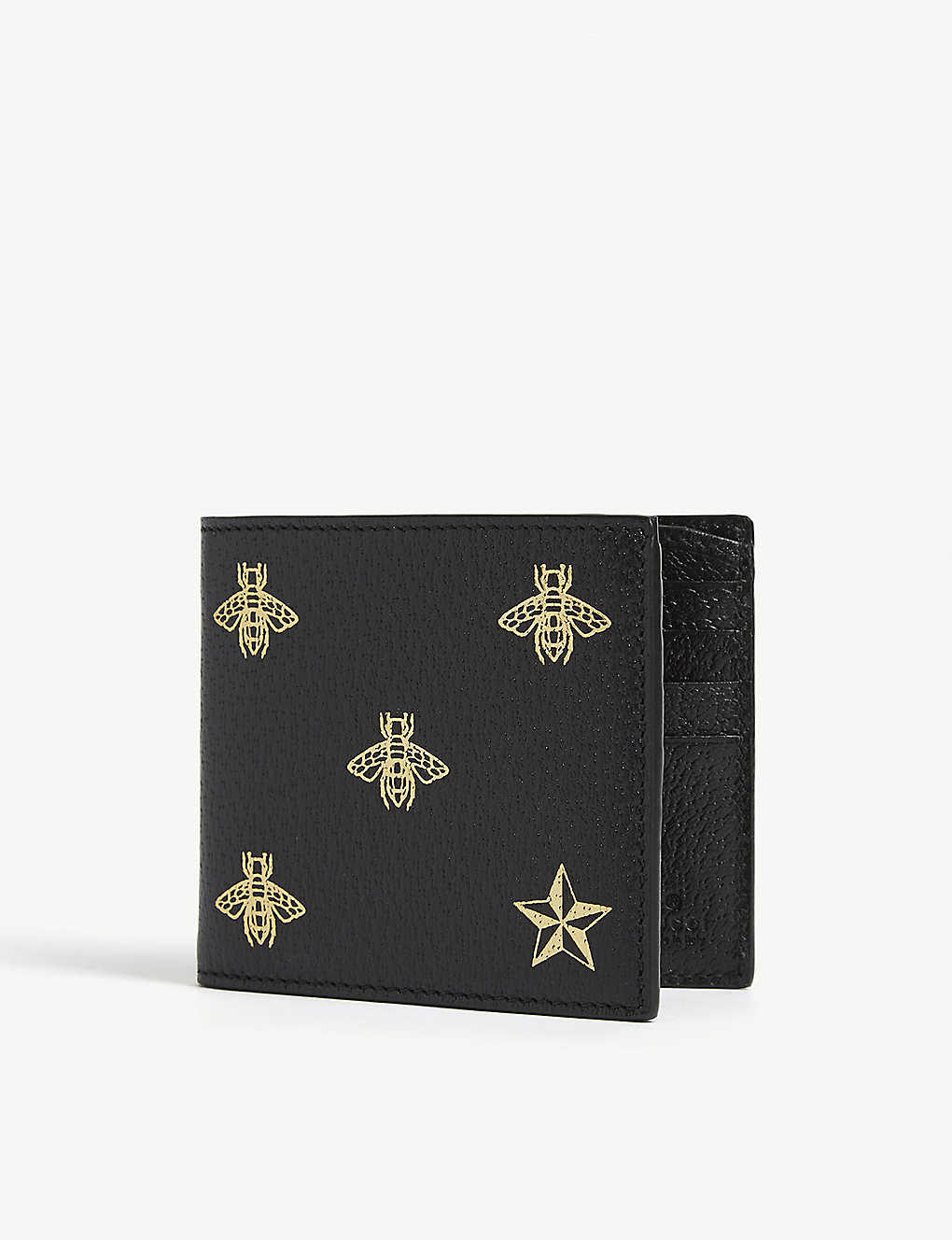 GUCCI: Gold-foil bumblee and star print leather bifold wallet