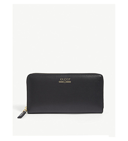 3aa01361ebcc GUCCI - Logo-print leather purse | Selfridges.com