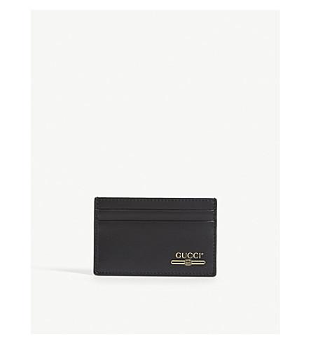 9de5a741746 GUCCI Gold print logo leather cardholder (Black