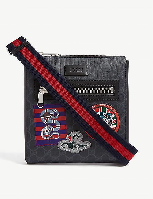 54c273d95bf4cb GUCCI - Courrier GG Supreme messenger bag | Selfridges.com