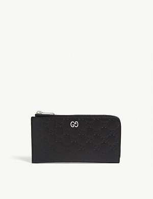 GUCCI Signature embossed leather zip wallet