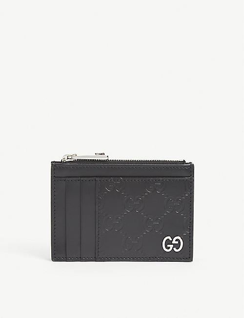 GUCCI: Dorian Signature embossed leather card holder