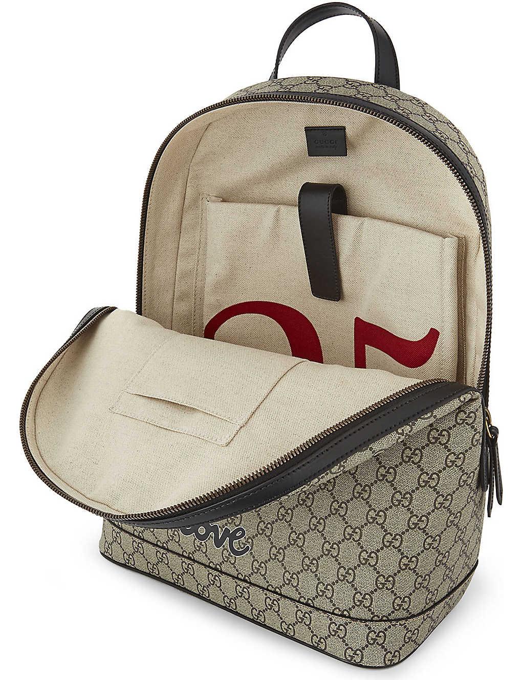 ce54e287225cd6 GUCCI - Bee print GG Supreme backpack | Selfridges.com