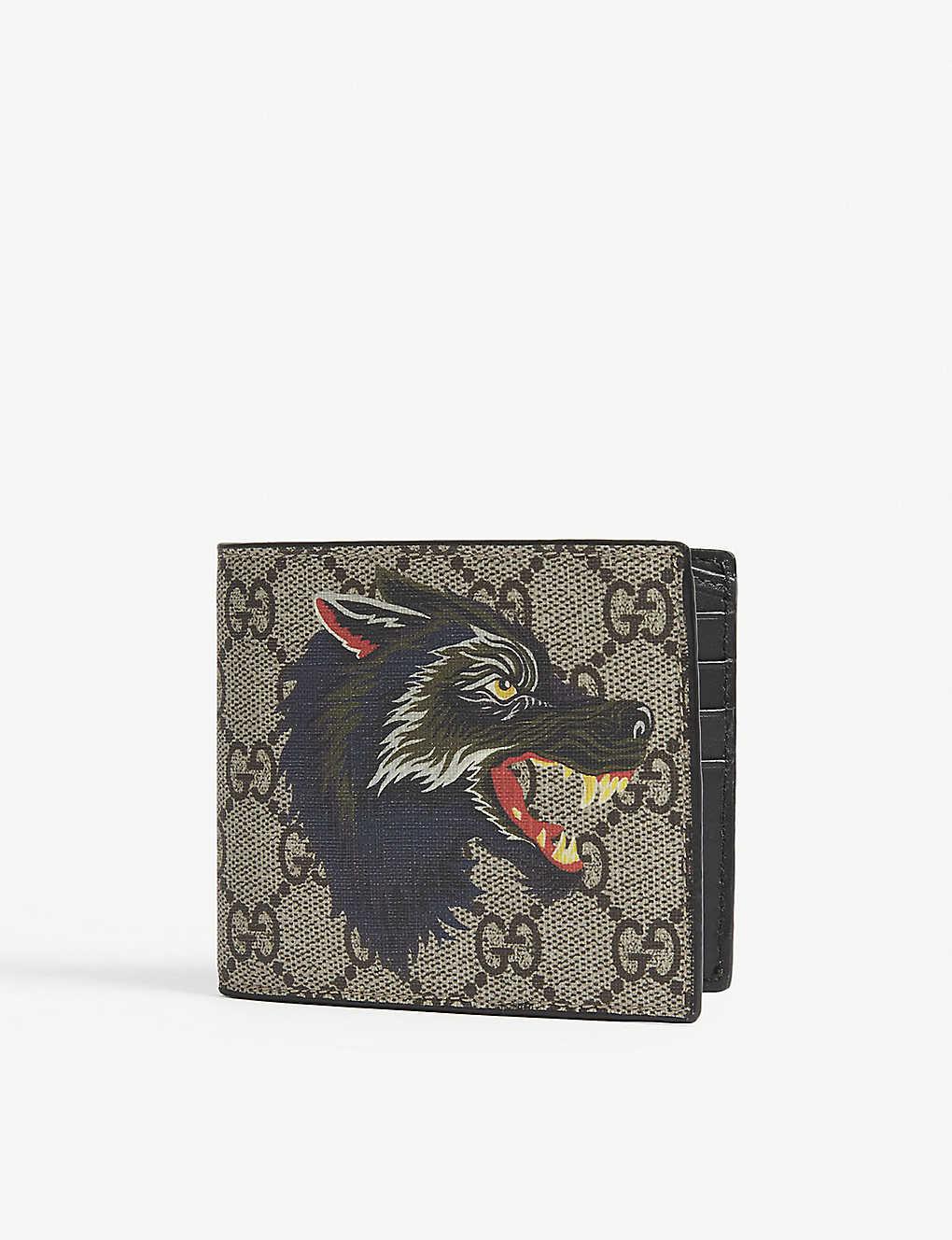 a0de806e85ee GUCCI - Wolf print GG Supreme billfold wallet | Selfridges.com