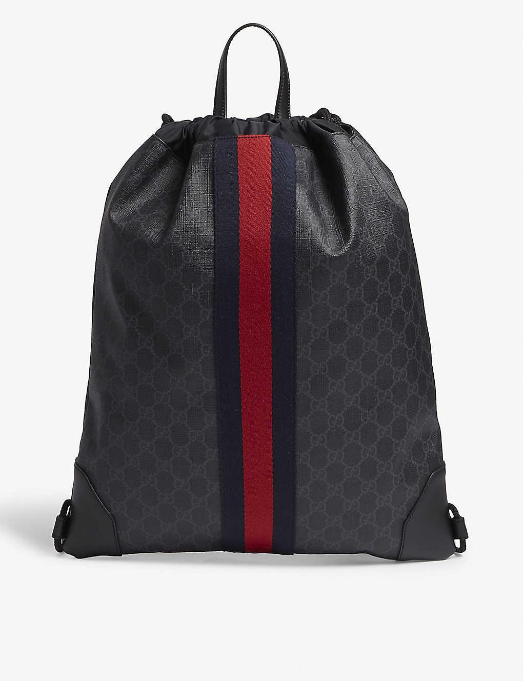 84998c9e382d GUCCI - Web stripe leather drawstring bag | Selfridges.com