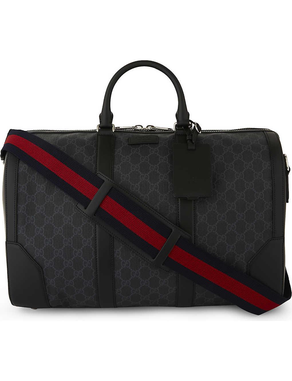 3065671cd GUCCI - Supreme canvas and leather duffle bag | Selfridges.com