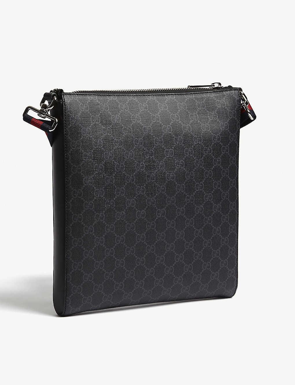 888e3e13696c GUCCI - GG Supreme patches messenger bag   Selfridges.com