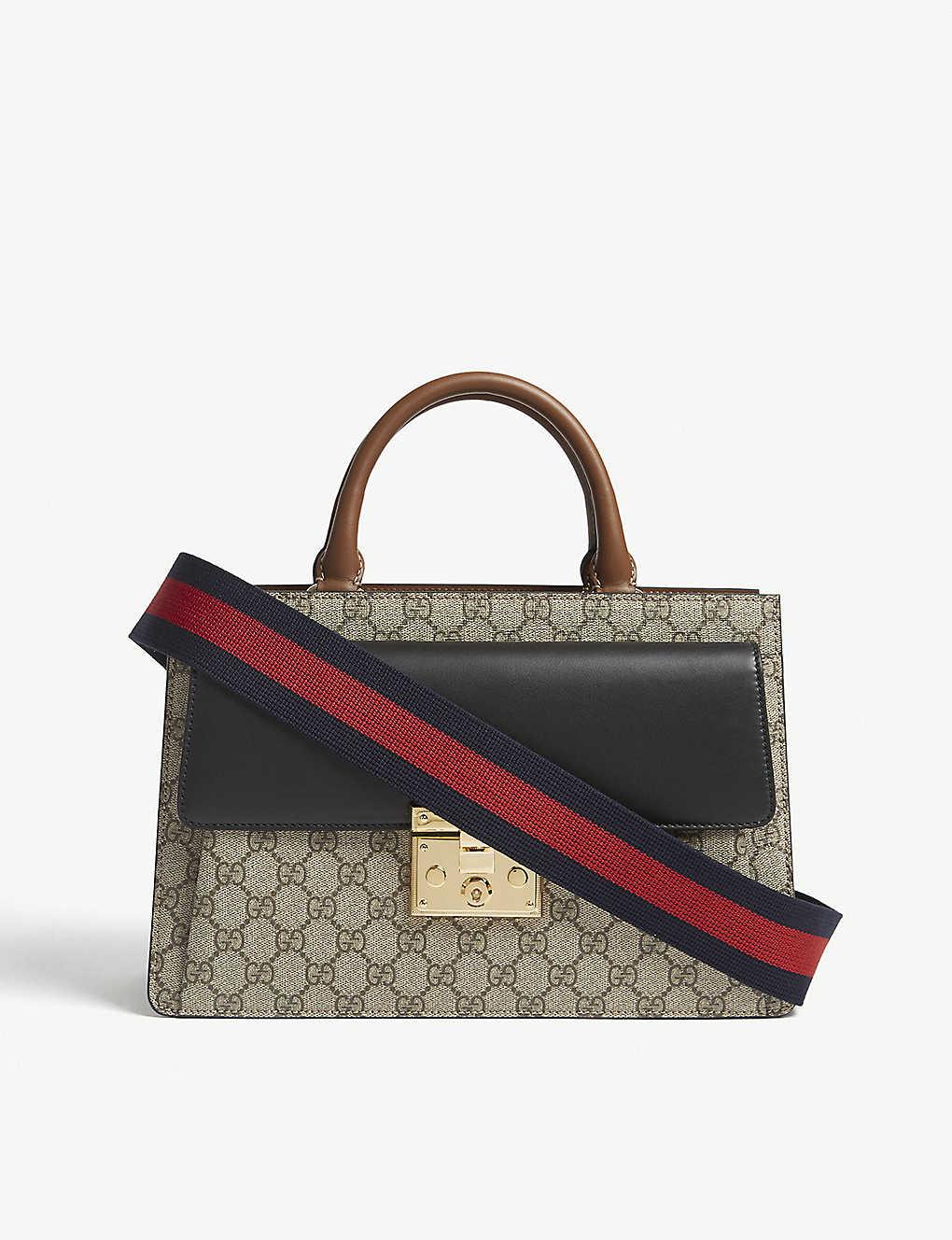 35ad27179281 GUCCI - Padlock GG Supreme and leather shoulder bag | Selfridges.com