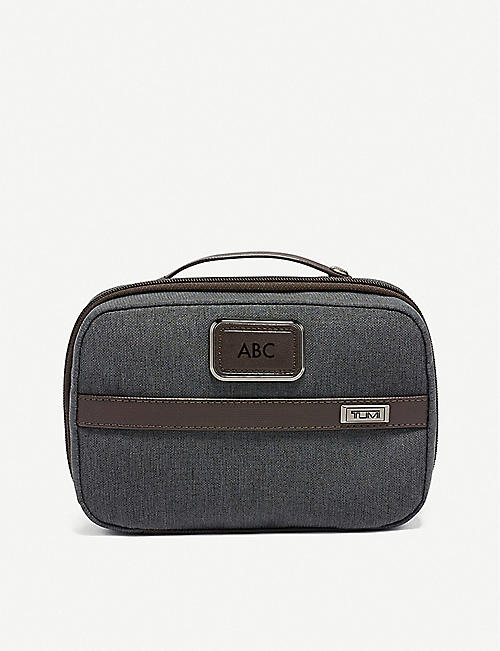 TUMI: Split ballistic nylon travel bag