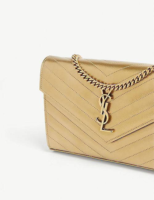08f7fa1108 SAINT LAURENT Monogram quilted leather clutch. NEW SEASON. Quick Shop