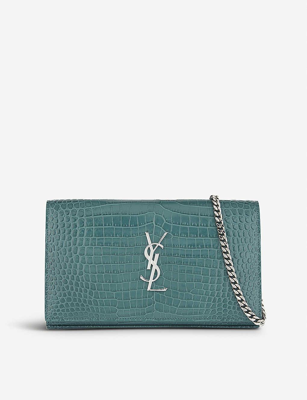 b62cfba33c6 SAINT LAURENT - Croc-embossed leather clutch bag | Selfridges.com