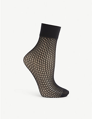WOLFORD: Fishnet ankle socks