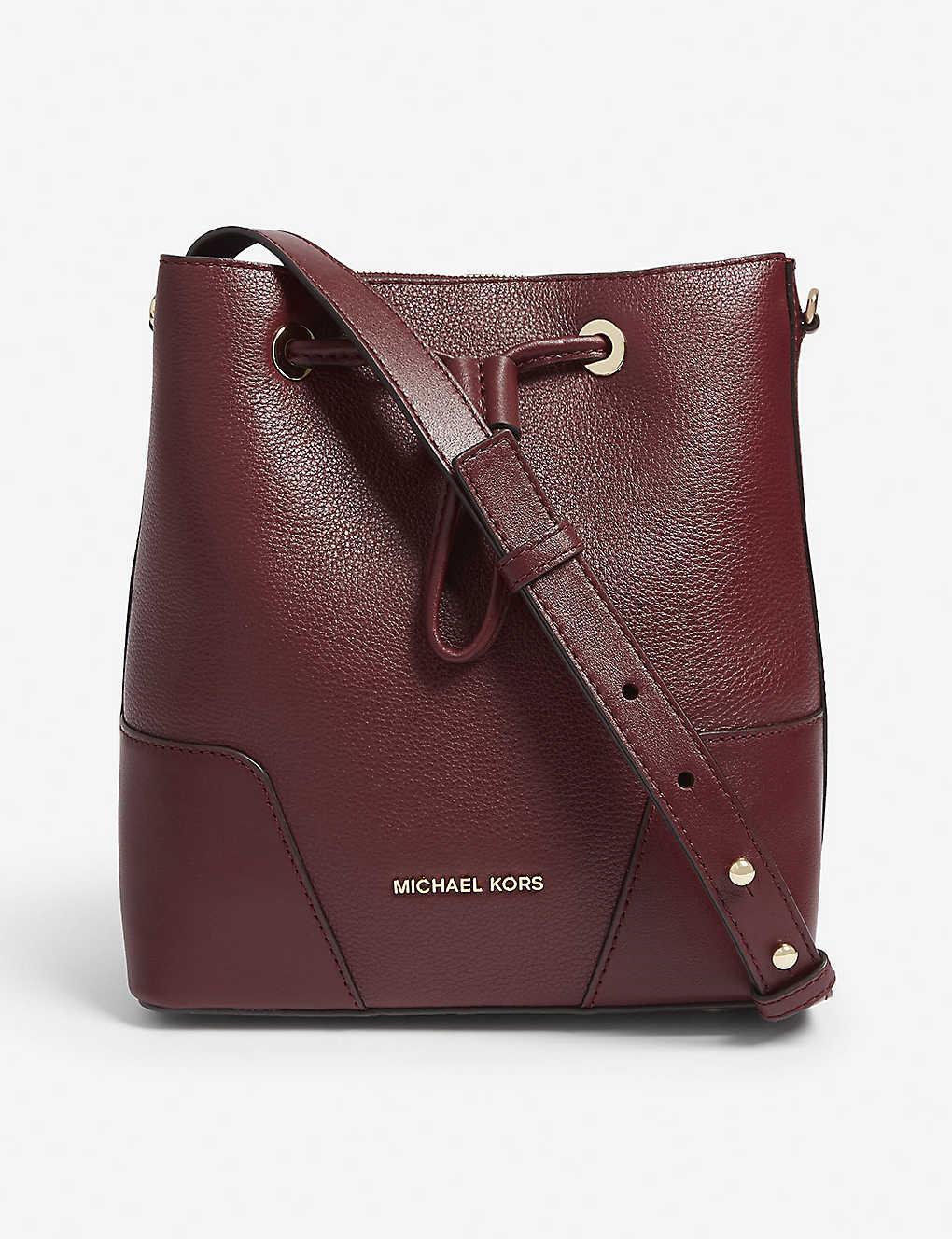 196f185380b6 MICHAEL MICHAEL KORS - Cary leather bucket bag | Selfridges.com