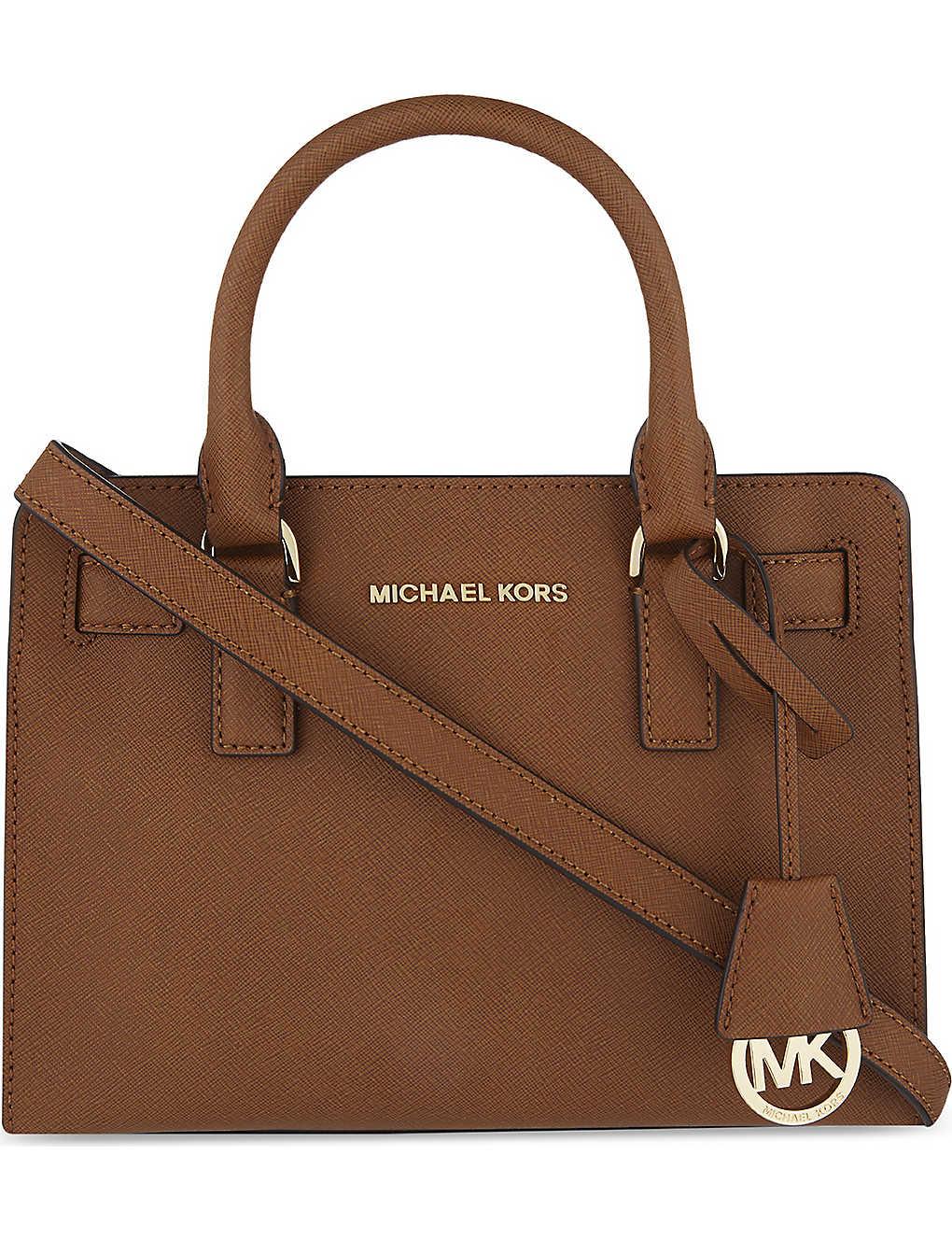 b5d229aa407d70 MICHAEL MICHAEL KORS - Dillon saffiano leather satchel | Selfridges.com