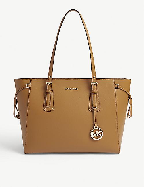 9c4f0341eff84 MICHAEL MICHAEL KORS - Voyager leather tote bag | Selfridges.com