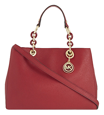 fdcde2db184a ... MICHAEL MICHAEL KORS Cynthia medium Saffiano leather satchel (Cherry.  PreviousNext