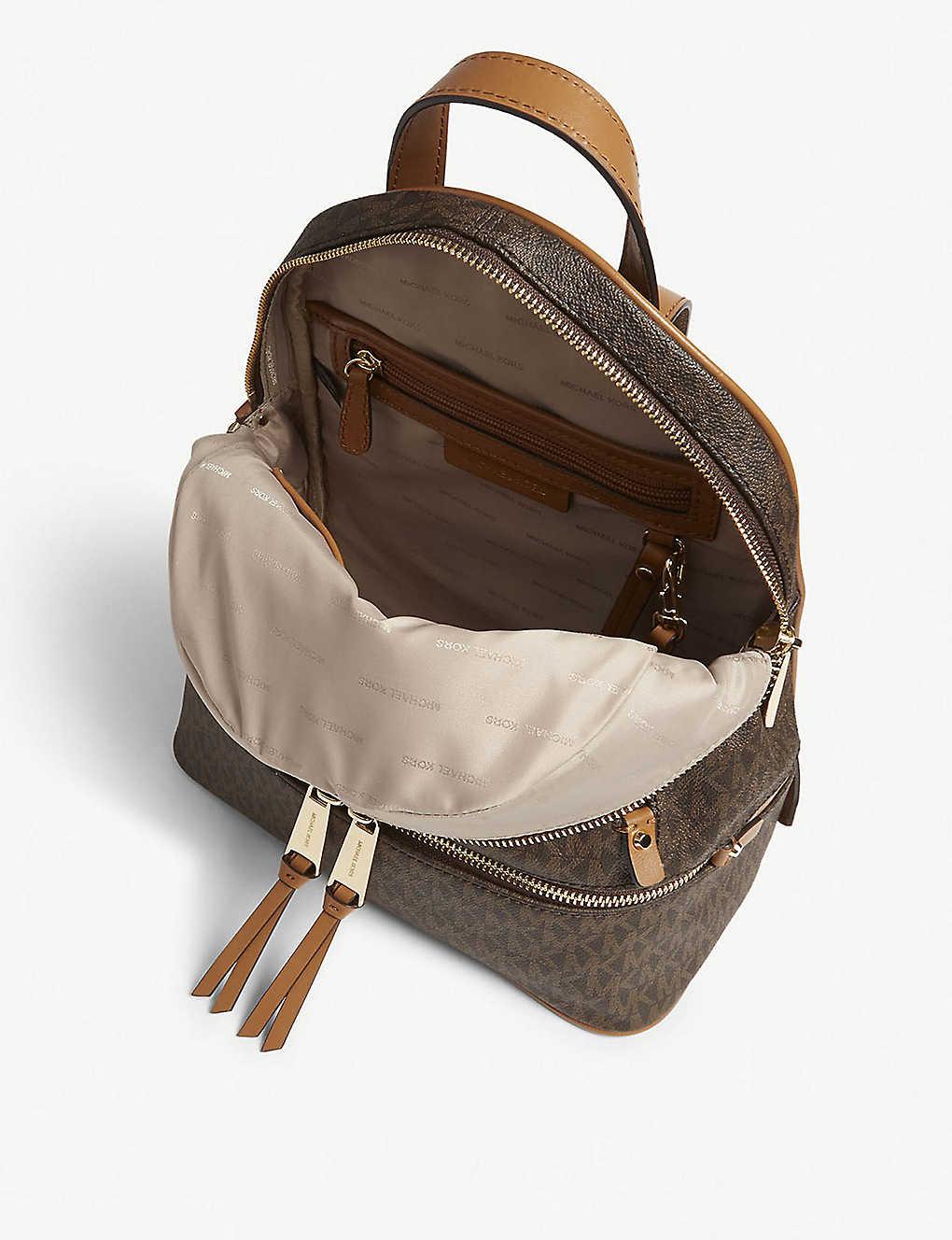 363deeddc1e0 MICHAEL MICHAEL KORS - Rhea medium leather backpack | Selfridges.com