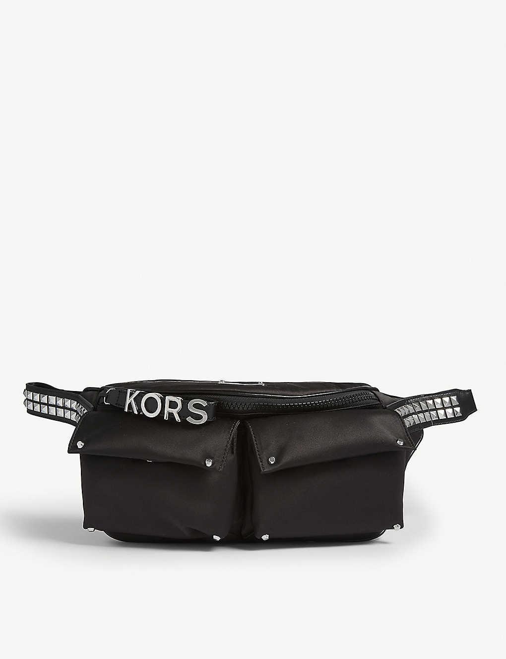 54c9b0dff9c8 MICHAEL MICHAEL KORS - Olivia studded nylon belt bag | Selfridges.com